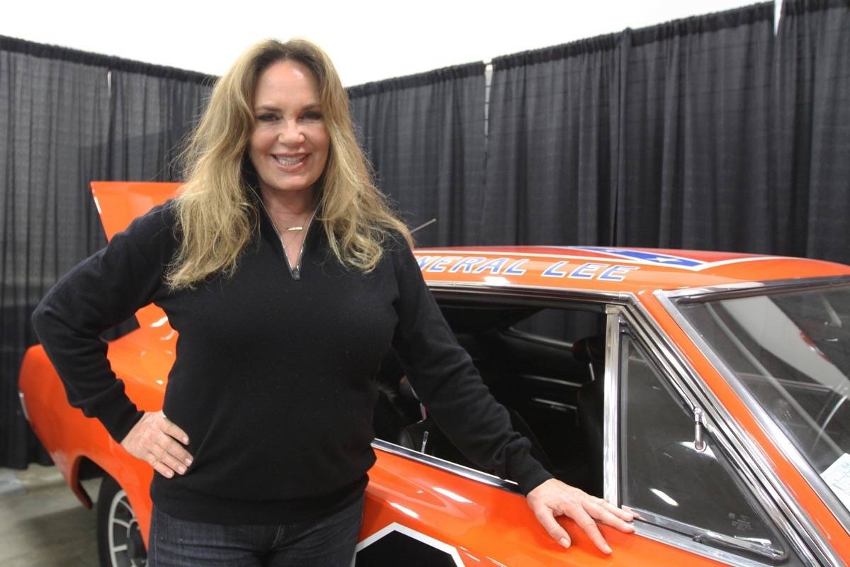 VIDEO Daisy Duke Joins Red Deerians At Collector Car Auction And - Car auction show
