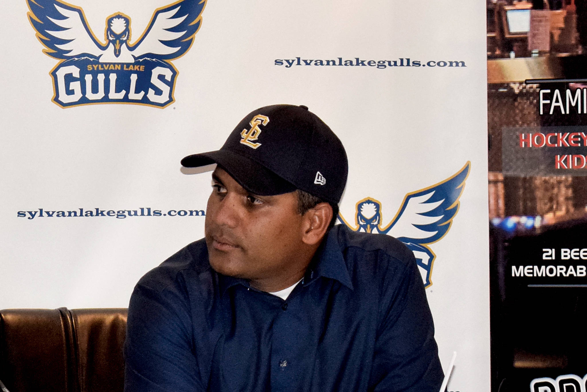Head Coach Jason Chatwood (left) sports one of the Sylvan Lake Gulls' first on-field hats next to Aqil Samuel, general manager and president of baseball operations, at Hockey Central on July 26. (Photo by Sylvan Lake News)