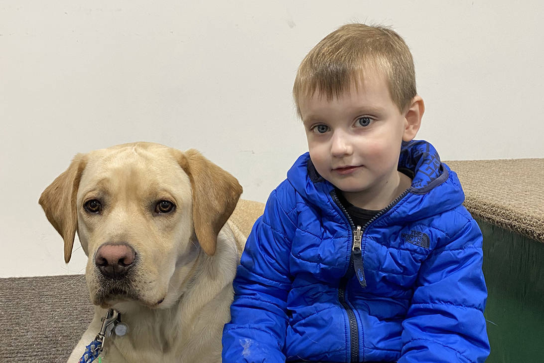 Pictured here is Stettler's Jenner Smith with a guide dog from Aspen Service Dogs Inc. An online auction will be running soon to help raise funds for Jenner to receive his very own service dog later this year. Jenner, who is four years old, was diagnosed with Autism Spectrum Disorder in 2019. photo submitted